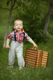 Little boy with suitcase Stock Image