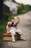 Little boy with suitcase Stock Photos