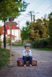 Little boy with suitcase and map and sign Stock Photo