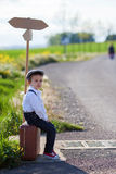 Little boy with suitcase and map Royalty Free Stock Photo