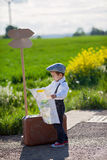 Little boy with suitcase and map, traveling Royalty Free Stock Images