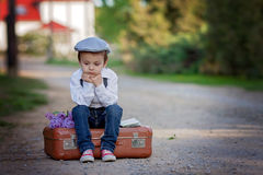 Little boy with suitcase and map, traveling Royalty Free Stock Image