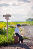 Little boy with suitcase and map, traveling Stock Image