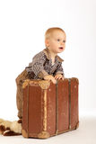Little boy with suitcase. Little boy with old brown suitcase goes into the world Royalty Free Stock Photo