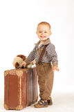 Little boy with suitcase. Little boy with old brown suitcase goes into the world Stock Photo