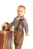Little boy with suitcase. Little boy with old brown suitcase goes into the world Stock Photography
