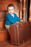 Little boy and suitcase Stock Images