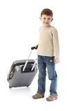 Little boy with suitcase smiling Royalty Free Stock Photo