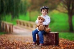 Little boy with suitcase and teddy bear Stock Photos