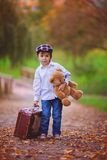 Little boy with suitcase and teddy bear Royalty Free Stock Photography