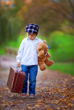 Little boy with suitcase and teddy bear Royalty Free Stock Photo