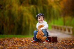 Little boy with suitcase and teddy bear Stock Photography