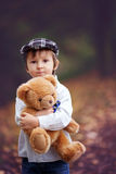 Little boy with suitcase and teddy bear Royalty Free Stock Images