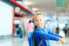 Little boy with suitcase travel in the airport Stock Image
