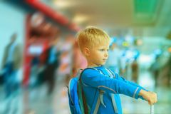 Little boy with suitcase travel in the airport. Family travel stock photos