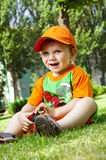 Little boy is in summer on a lawn stock photo
