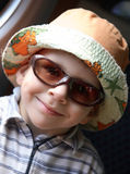 Little boy with sunglasses and hat Royalty Free Stock Image