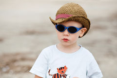 Little boy in sunglasses and a hat Stock Photos