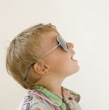 Little boy in sunglasses with money smiling, against white background Royalty Free Stock Photos