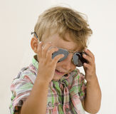Little boy in sunglasses with money smiling, against white background Royalty Free Stock Images