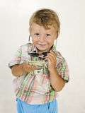Little boy in sunglasses with money smiling, against white background Stock Image
