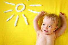 Little boy with sunglasses and sun shape Stock Images