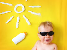 Little boy with sunglasses and sun shape Royalty Free Stock Photos