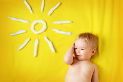 Little boy with sunglasses and sun shape Royalty Free Stock Photography
