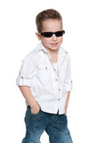 Little boy in sunglasses on the white Stock Image