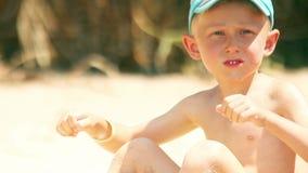 Little boy sunny beach portrait stock video