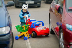 Little boy on supermarket parking Royalty Free Stock Photography