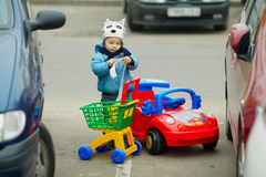 Little boy on supermarket parking Royalty Free Stock Photos