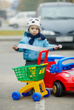 Little boy on supermarket parking Royalty Free Stock Images