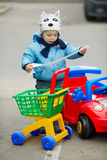 Little boy on supermarket parking Royalty Free Stock Image