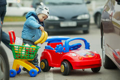 Little boy on supermarket parking Royalty Free Stock Photo