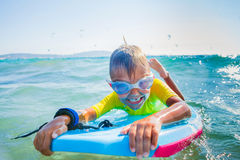 Little boy surfboarding Royalty Free Stock Image