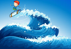 A little boy surfing at the sea Stock Photo