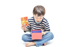 Little boy surprise with gift box. On white background Royalty Free Stock Image