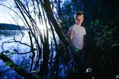 Little boy on swamp Royalty Free Stock Photos