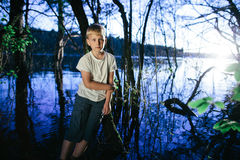 Little boy on swamp Royalty Free Stock Images
