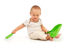 Little boy sweeping Stock Photo