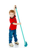 Little boy sweeping the floor brush Stock Photography