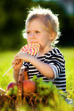 Little boy with a sweet Royalty Free Stock Image