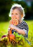Little boy with a sweet Royalty Free Stock Images