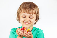 Little boy with sweets and candies on white background Royalty Free Stock Image
