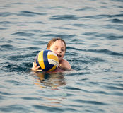 Little boy swimming with ball Royalty Free Stock Photos