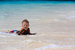 Little boy swimming at the beach Stock Image