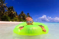 Little boy swimming at the beach Royalty Free Stock Photography