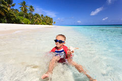 Little boy swimming found shell on beach Royalty Free Stock Photo