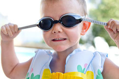 Little boy in swimming goggles on a hot summer day Royalty Free Stock Photos